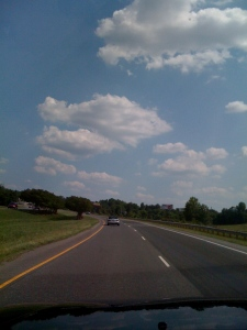 Carolina blue sky and cotton ball clouds (and my mama in her miata just in front of me)